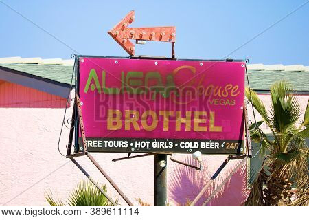 October 6, 2020 In Lathrop, Nv:  Alien Brothel At A Pink Building Taken In Lathrop, Nv Where Tourist