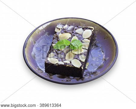 Homemade Dark Chocolate Fudge Brownies Cake Topping With Almond Slices On White Isolated Background