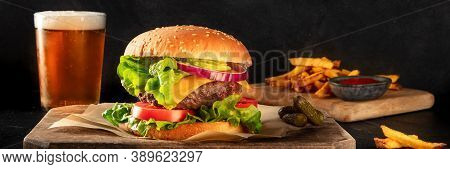 Burger And Beer Panorama. Hamburger With Beef, Cheese, Onion, Tomato, And Green Salad, With Pickles