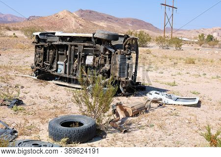 October 4, 2020 In Beatty, Nv:  Abandoned Cars On An Arid Plain At An Unofficial Junkyard Where Peop