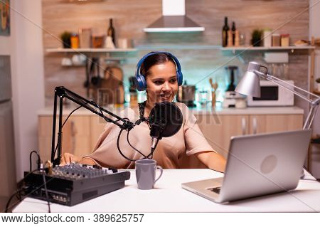 Famous Influencer Hosting Online Show In Home Studio Using Professional Gear. Online Show On-air Pro