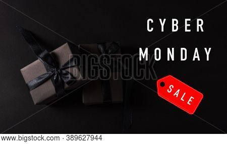 Cyber Monday Sale Shopping Concept, Top View Of Gift Box Wrapped In Black Paper And Black Bow Ribbon