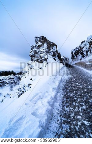 Snowy Wintry Footpath In Iceland. Path That Leads Up The Mountain Full Of Ice In Winter.