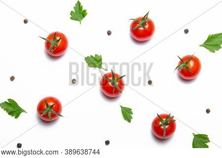 Cherry Tomatoes On A White Background . Background Vegetables. Copy Space. Small Tomatoes. Article A