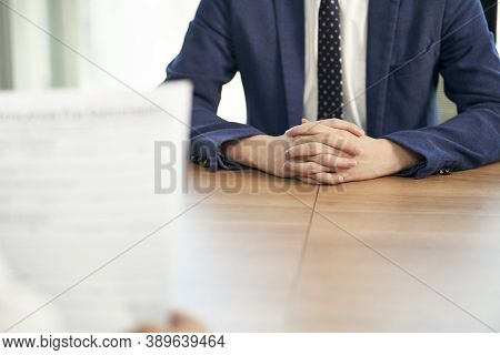 Asian Job Seeker Being Interviewed By Human Resources Manager In Office, Focus On Hands Of The Candi