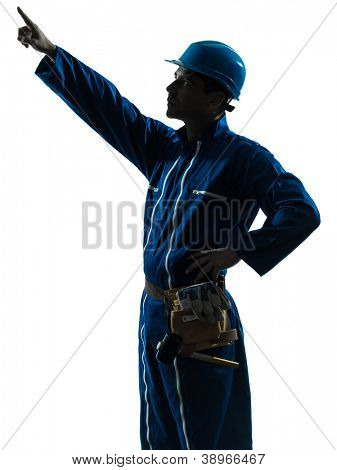 one caucasian man construction worker pointing showing silhouette portrait in studio on white background