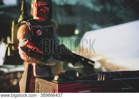OCT 13 2020: Recreation of a scene from Star Wars The Empire Strikes Back with bounty hunter Boba Fett and Han Solo frozen in carbonite - Hasbro action figures