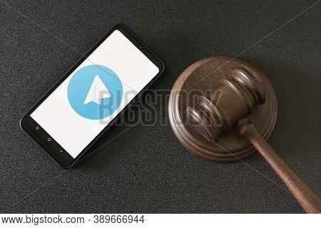 Kharkov, Ukraine - June 25, 2020: Telegram App On Smart Phone Screen And Mallet Of The Judge. Telegr