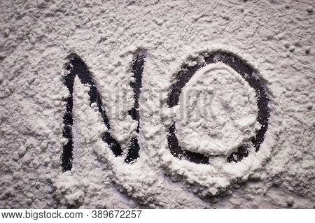 Word No Written In White Flour Powder, Concept Of Saying No To Drug Abuse And Narcotis. Flour Repres