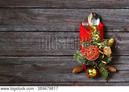 Christmas Dinner. Christmas Day. Christmas Table Place Settings. Cutlery On The Red Napkin, Christma
