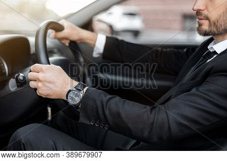 Unrecognizable Businessman Driving Car To Airport, Going On Business Trip, Side View, Cropped. Beard