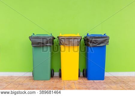 Group Of Colorful Recycle Bins Green Background, Different Colored Bins For Collection Of Recycled M