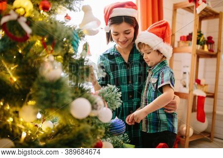 Happy Family Mom And Son On A Christmas Winter Sunny Morning In A Decorated Christmas Celebration Ro