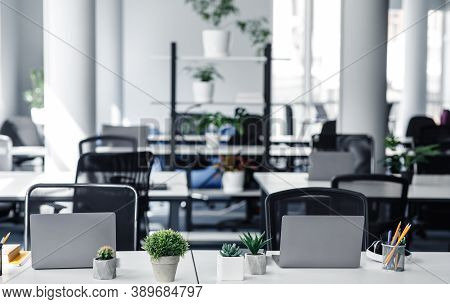 Coworking Eco-office And Absence Of Workers During Quarantine. Empty Workplaces Without People With