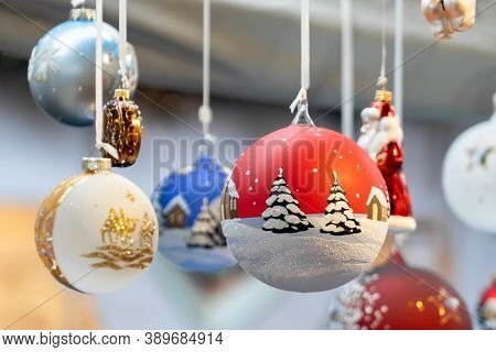 Christmas Glass Ball Ornaments At A Christmas Market In Milan, Europe. Buying Presents And Gifts In