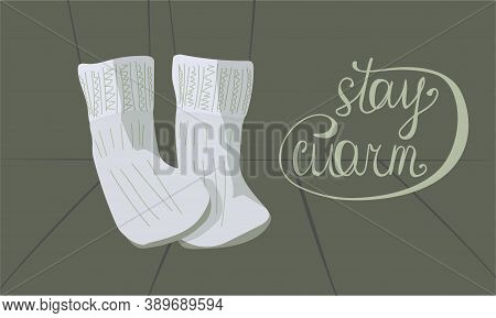 Light Gray Knitted Warm Socks And The Inscription Stay Warm On A Gray-green Background. Contours Of