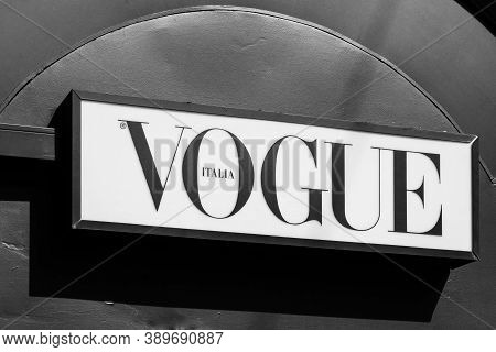 Vogue Brand Logo Sign On A Newspaper Kiosk. Vogue Is Monthly Fashion And Lifestyle Magazine Covering