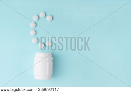 Vitamin C Pills Dropped From Bottle On Blue. Letter C From Tablets. Vitamin C Concept. Immunity Prot