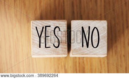 Concept Of Choice Yes Or No On Wooden Cubic Blocks. Business And Lifestyle Concept