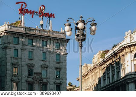 Ray-ban Brand Logo Sign On The Top Of Building In The Center Of The City. Ray-ban Is An American-fou