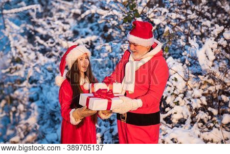 Frosty Christmas Morning. Santa And Granddaughter. Time For Miracles. Generous Santa Claus. Child Ha