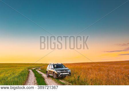 Gomel, Belarus - June 24, 2018: Car Renault Duster Or Dacia Duster Suv In Summer Field Countryside L