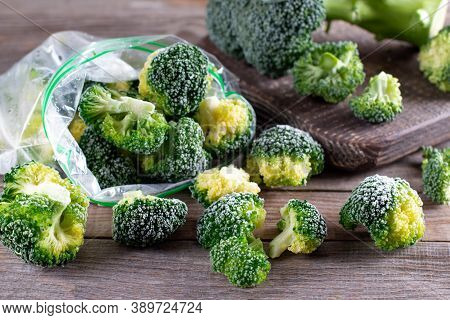 Frozen Broccoli In A Plastic Bag On Wooden Table. Selective Focus. Frozen Broccoli Florets, Cabbage