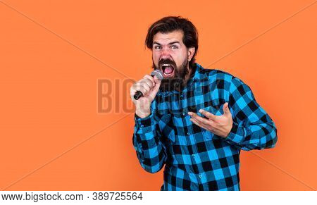 Male Singing In Mic. Handsome Hipster On Party. Music. Mature Man Sing A Song. Vocal Classes. Style
