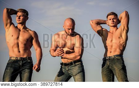 Group Muscular Men Outdoors. Athletic Bodybuilders. Sport Concept. Muscular Body. Muscular Means Pow