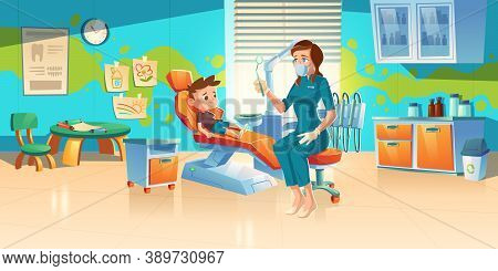 Child At Dentist Office. Little Boy Patient At Dental Clinic For Kids, Female Doctor In Medic Robe A
