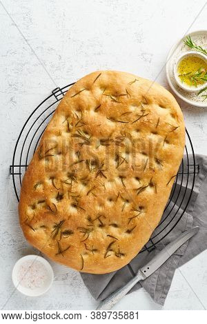 Focaccia, Pizza, Italian Flat Bread With Rosemary And Olive Oil On Grid