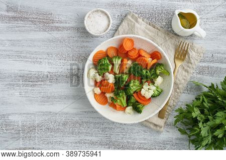 Mix Of Boiled Vegetables. Broccoli, Carrots, Cauliflower. Steamed Vegetables