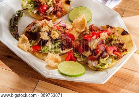 Mexican Longaniza Sausage And Steak Street Tacos Campechanos With Chicharron Pork Rinds And Tomatill