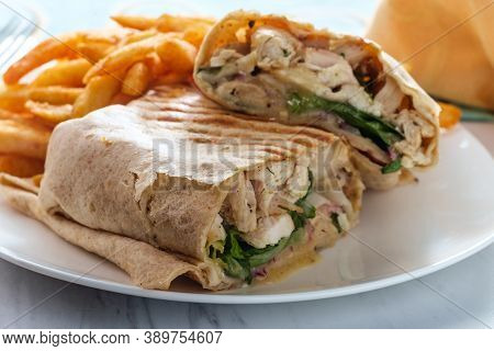 Chicken Caesar Salad Wrap Sandwich With Romaine Lettuce And French Fries