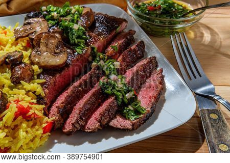 Juicy Rare Chimichurri Verde Grilled Club Steak With Yellow Rice And Mushrooms