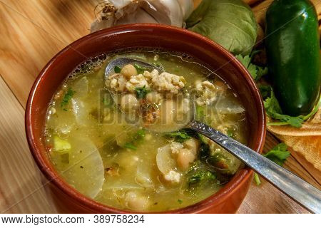 Ground Pork Green Chili Con Carne With Tomatillo And Navy Beans