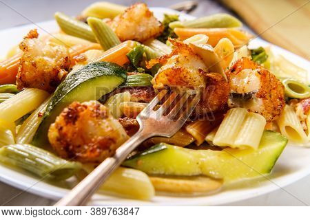 Shrimp Primavera With Tricolor Penne In A White Wine Sauce