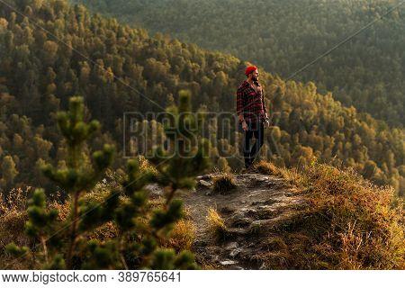Traveler In The Mountains. A Man Enjoys A Beautiful View Of The Mountains. Man At Sunrise In The Mou