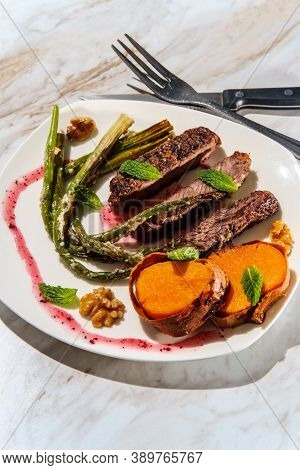 Well Done Sliced Beef Rib Boneless Club Steak With Parmesan Garlic Asparagus And Baked Sweet Potatoe