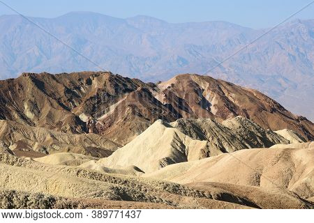Colorful Barren Hills Rich With Mineral Deposits Taken On An Arid Plain In Death Valley, Ca