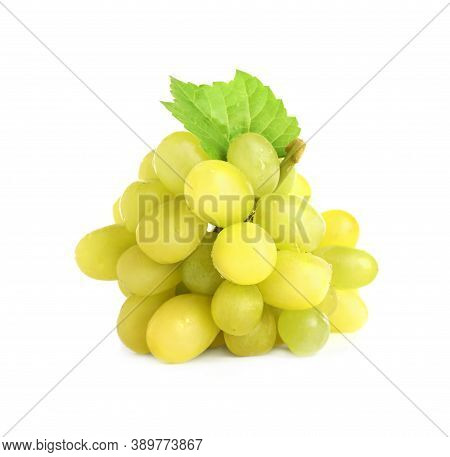 Bunch Of Green Grapes With Fresh Leaf Isolated On White