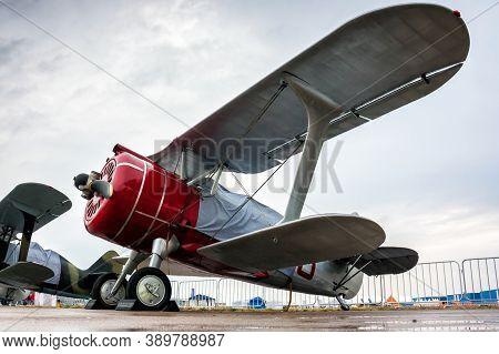 Retro Biplanes In The Parking Lot Under A Little Rain