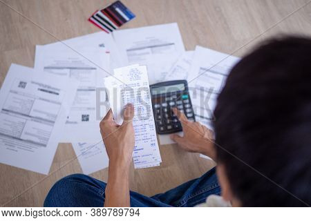 Businessman Or Butler Is Sitting At The Press Of Various Expense Calculators On Invoices And Credit