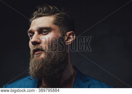 Closeup Photography In Side View Of Brutal Businessman In Blue Suite With Beard And Stylish Haircut