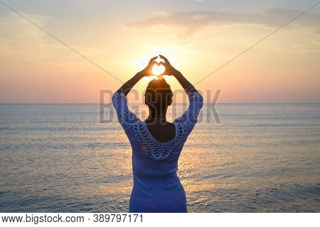 Woman Makes Heart With Hands On Beach. Happy People Lifestyle. Woman On Beach Making Heart With Hand