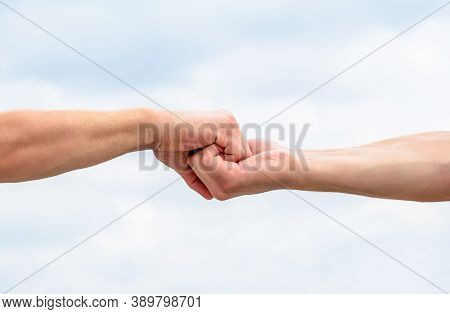 Helping Hand Outstretched. Friendly Handshake, Friends Greeting, Teamwork, Friendship. Rescue, Helpi