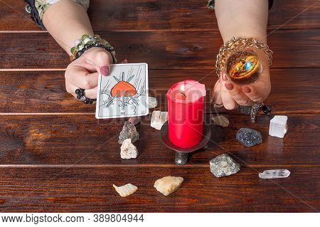 Bangkok,thailand,march.15.20.a Fortune Teller Holds A Magic Ball And A Tarot Card With A Heart.the G