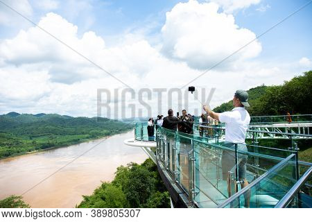 Tourists Walk And Take Pictures On The Sky Walk, A Beautiful New Landmark On The Mekong. Chiang Khan
