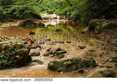 Muddy Rocky Stream After Rain In A Subtropical Forest