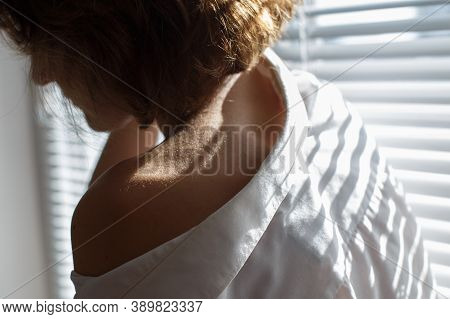 Sensual Close Up Portrait Of Beautiful Young Lady Relaxing At The Window. Female Shoulder Close Up.
